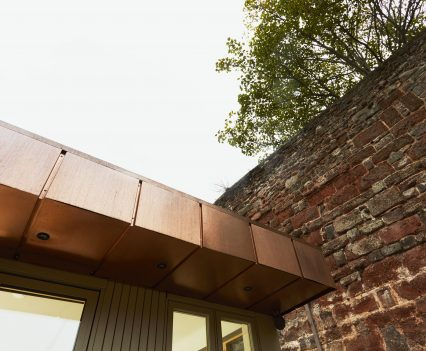 Copper and city wall - Exeter City Architects